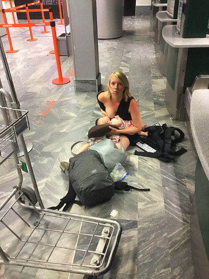 Breastfeeding on airport floor